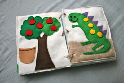 The apples and the spots on the dinosaur are moveable!