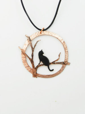 Because one can never have too many pendants, especially with cats on them.